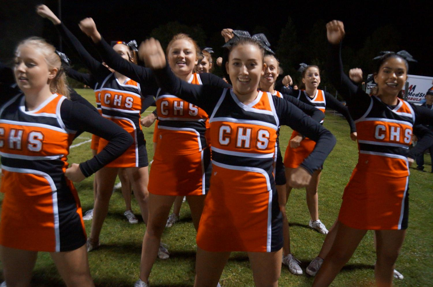 CHS cheerleaders fire up the crowd at the football game against Fairfield.