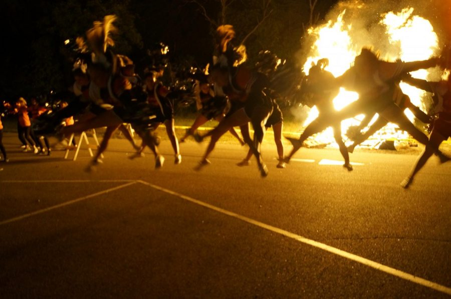 The+CHS+cheerleaders+were+en+fuego+during+the+bonfire+prior+to+the+homecoming+week+and+dance.+The+dance+team+also+performed+at+the+bonfire.