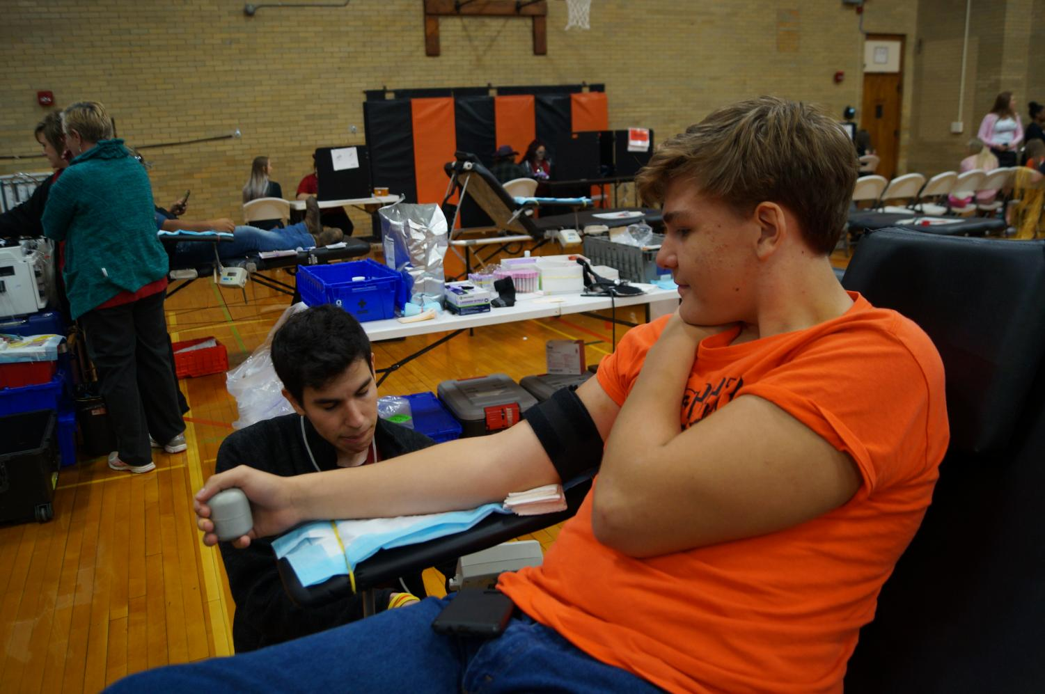 Sophomore Tyler Holm donates blood at the blood drive.