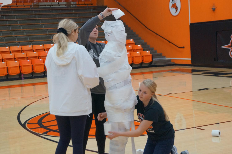 Seniors wrap mummy Erik Cowell during the Red Ribbon games.