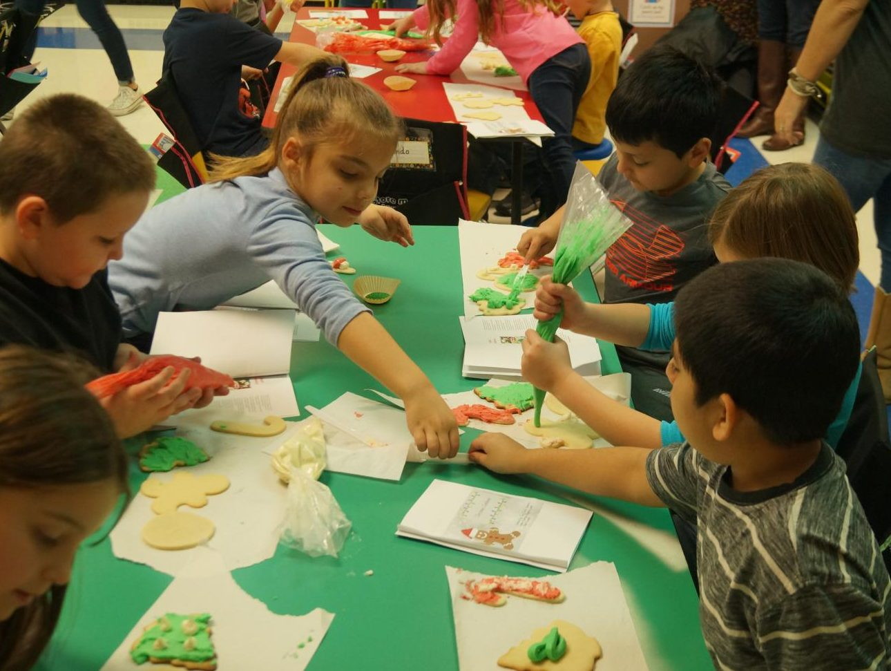 Chester Grade School students make Christmas cookies under the direction of CHS Culinary Arts students.