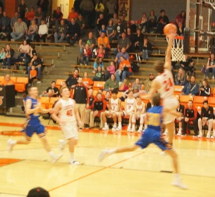 Colin Wingerter scores on a lay-up in Chester's win over Trico.