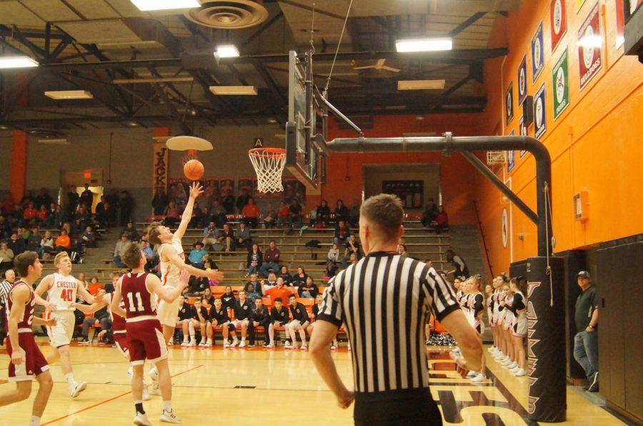 Colin+Wingerter+drives+to+the+basket+against+Gibault.