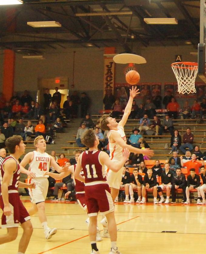 Colin Wingerter drives to the basket against Gibault.