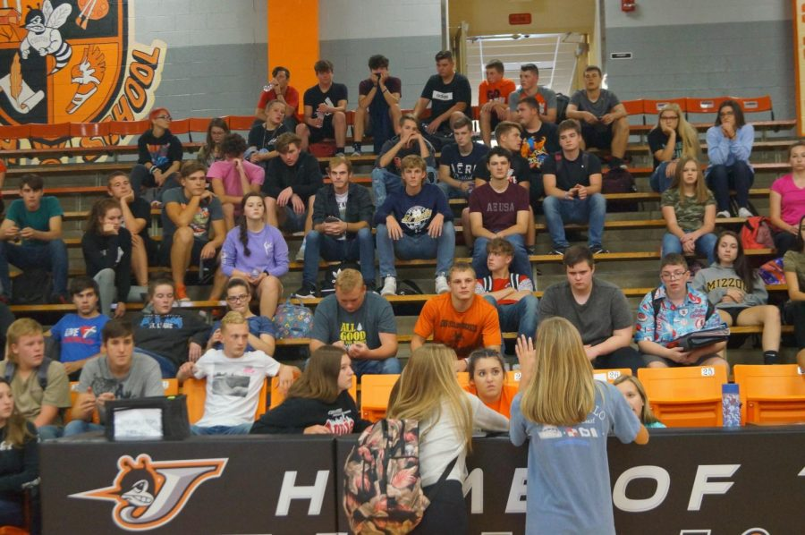 Class officers address the junior class during a meeting on Homecoming.