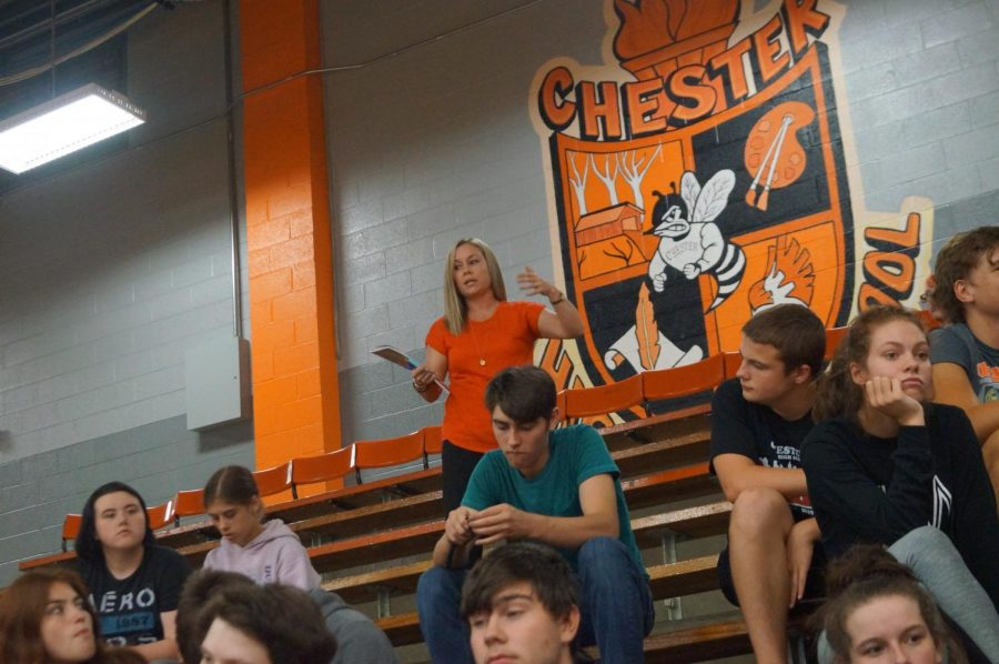 Mrs. Norman makes a point during the junior class meeting for Homecoming.