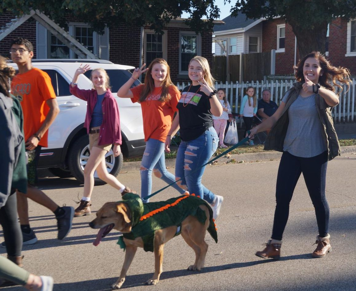 Ryn Petrowske and Chloe the Dinosaur Dog marched with the senior float.