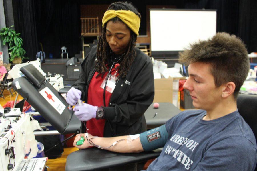 Gage Garniss donates blood.