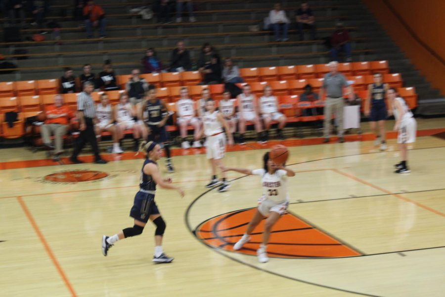 Destiny Williams defends a pass against Saxony Lutheran.