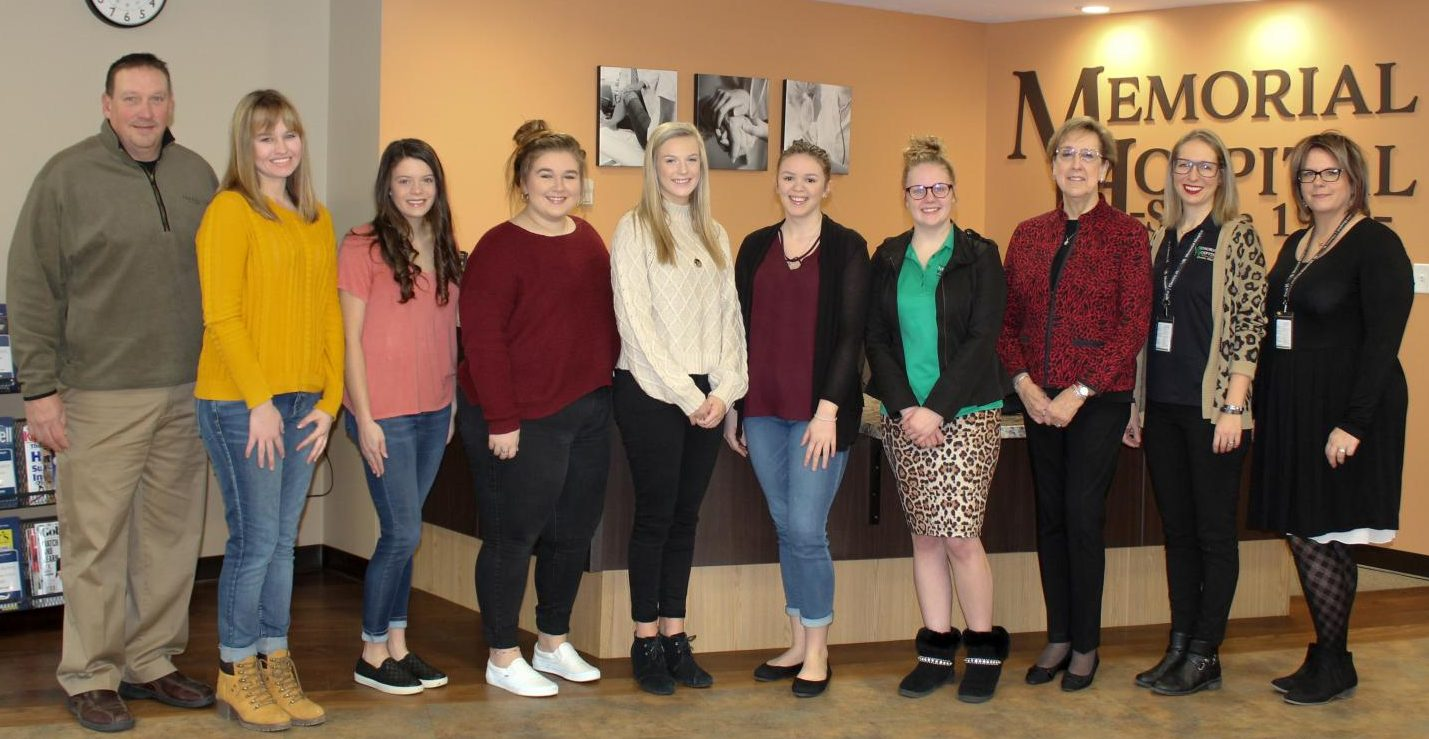 The Pathfinders for 2019-20 were announced. Pictured are Dan Colvis, board member; Pathfinders Mallary Vasquez, Ashtyn Jany, Mabry Miles, Avery Runge, Alexandria Hennerichs, Victoria Frederking, and Brianna Surman (not pictured in this photo); Auxiliary President Mardell Granger; Community Relations & Marketing Manager Mariah Bargman; and Chief Nursing Officer Susan Diddlebock.