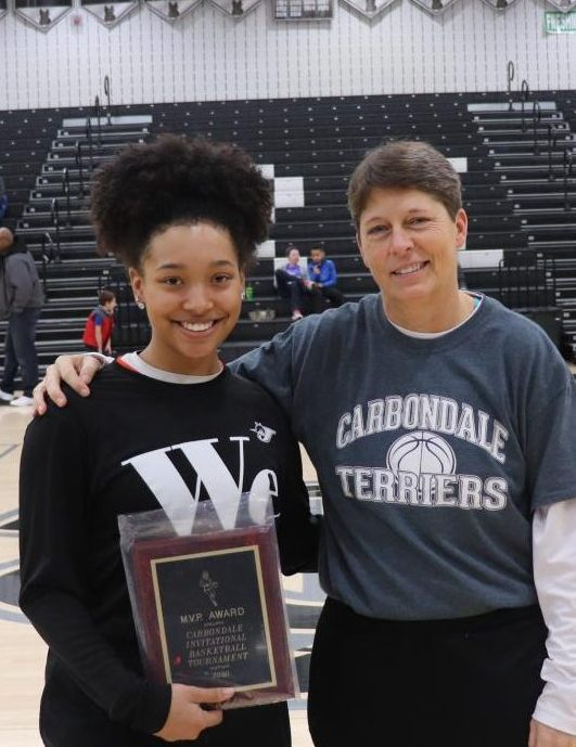 Destiny Williams received the Carbondale Mid-Winter Classic MVP award from Carbondale Assistant Athletic Director Marialice Jenkins.