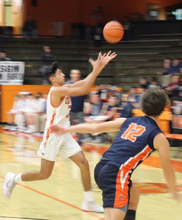 Jared Landeros chases a loose ball against Carterville.