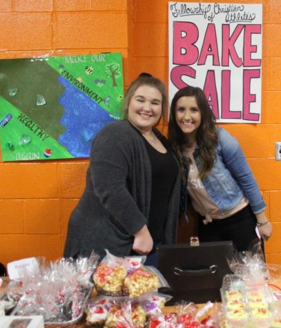 Mabry Miles and Ryn Petrowske helped with the Fellowship of Christian Athletes bake sale during the Chester-Carbondale game.