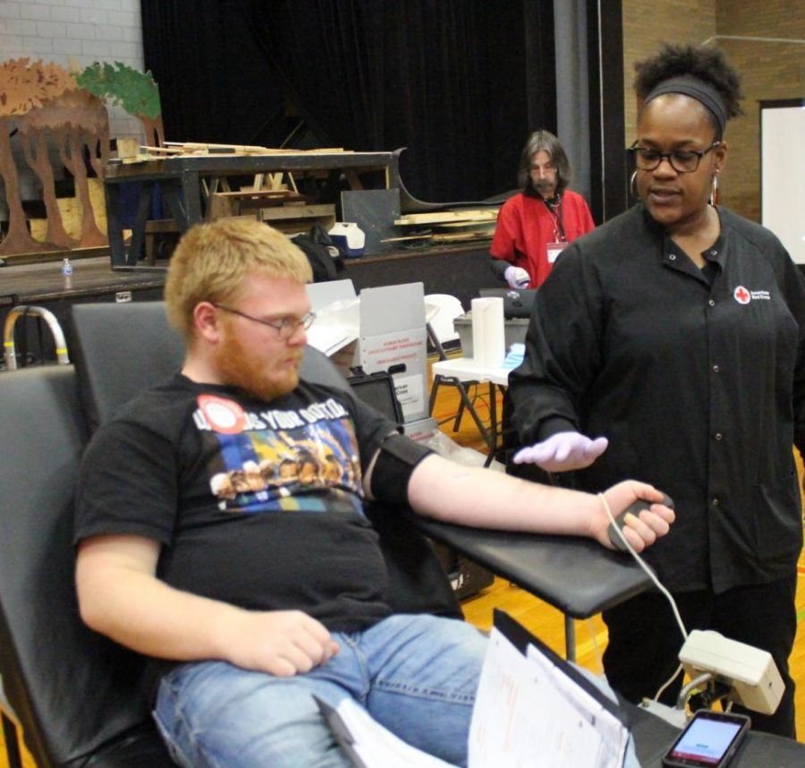 Andy Bryant donates blood.