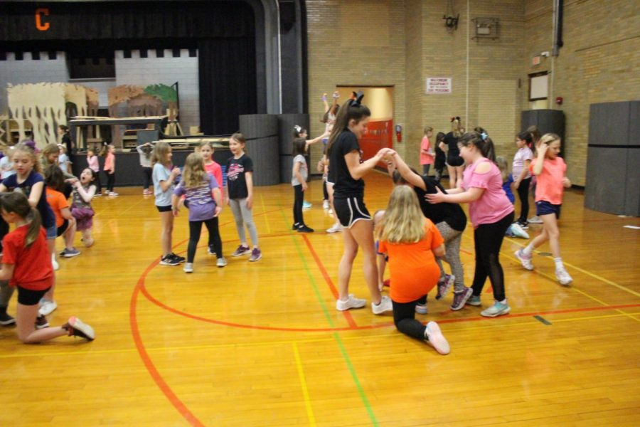 Youngsters work on routines at the CHS cheerleading camp.