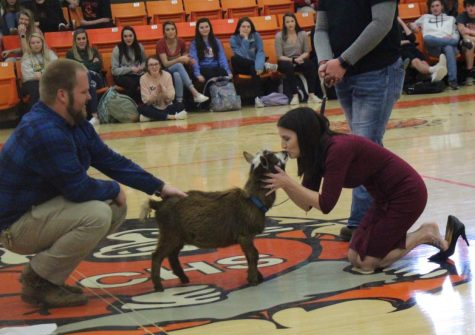 "Mrs. Hammel ""won"" the FFA kiss a goat contest and captured her ""prize"" during a school assembly Feb. 27."