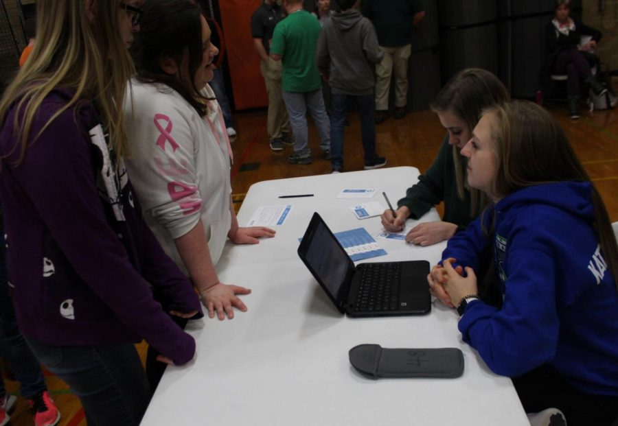 Kennedy Herrell and Josie Kattenbraker register students for the blood drive on Feb. 13.