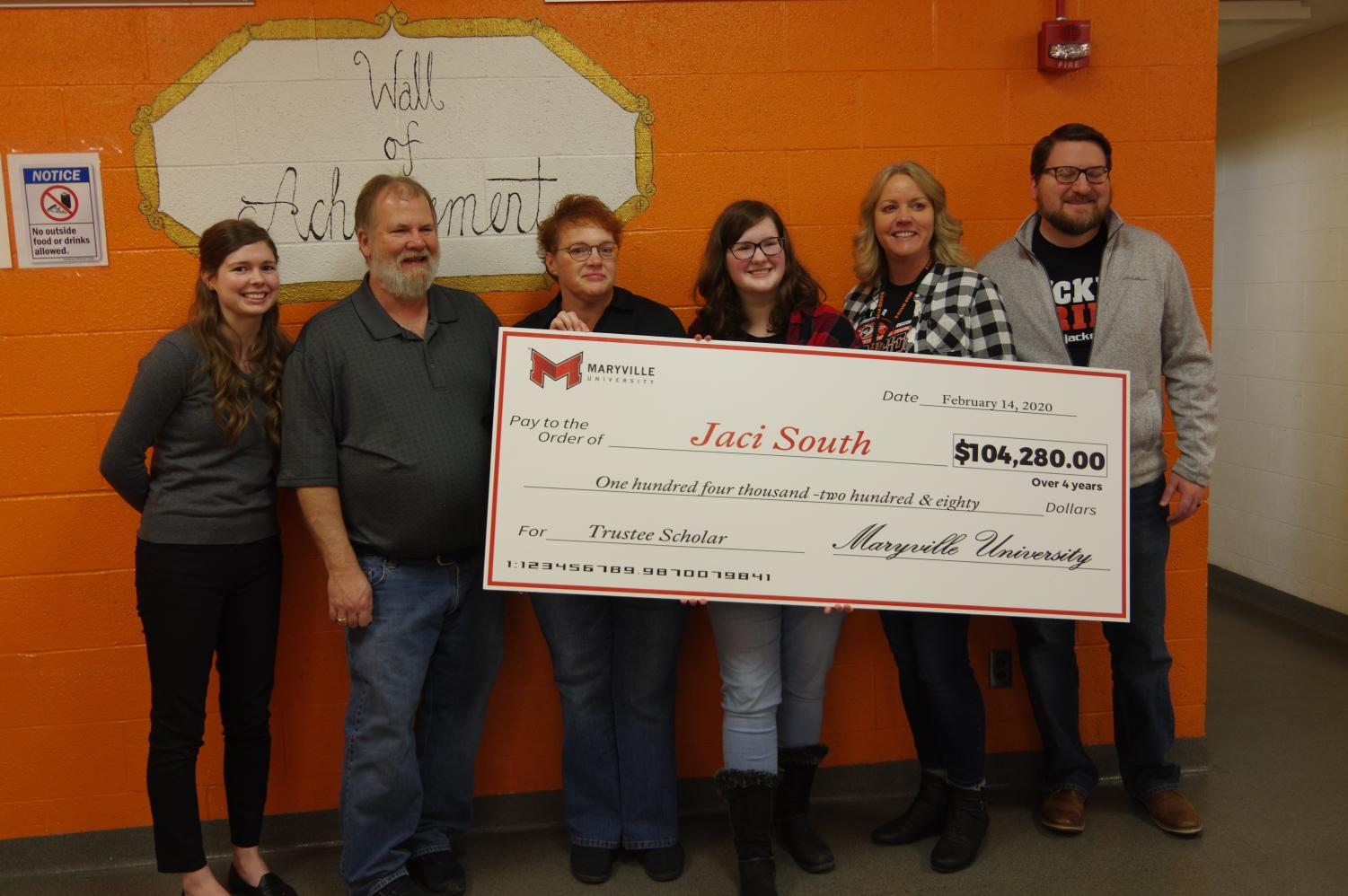 Maryville admission counselor poses for photo with check, along with Jerry, Jana, and Jaci South, Mrs. Meyer, and Mr. Guebert