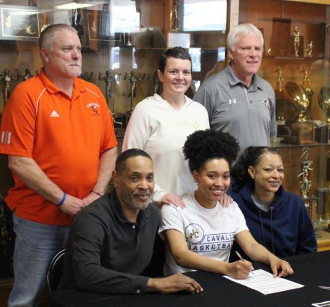 Destiny Williams front row, center) signs her letter of intent to play basketball at Johnson County Community College in Overland Park, Kans. She is flanked by parents Ron and Amy Williams. In the back are Chester coaches Rick Powley, Jennifer King and Pat Knowles.