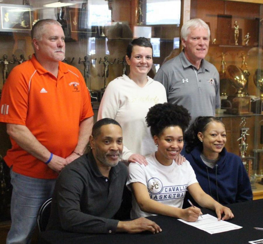 Destiny+Williams+front+row%2C+center%29+signs+her+letter+of+intent+to+play+basketball+at+Johnson+County+Community+College+in+Overland+Park%2C+Kans.+She+is+flanked+by+parents+Ron+and+Amy+Williams.+In+the+back+are+Chester+coaches+Rick+Powley%2C+Jennifer+King+and+Pat+Knowles.