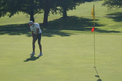 Jared Landeros lines up a putt against Zeigler-Royalton.