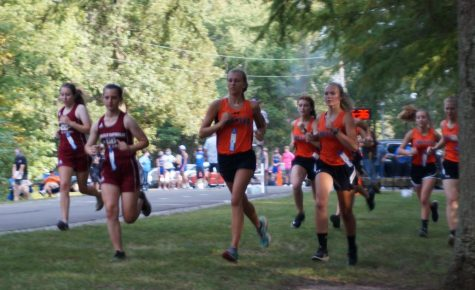 Josie Kattenbraker and Madison Kribs set the pace for the Chester girls in the Chester 7 meet Sept. 10 at the Randolph County Lake.