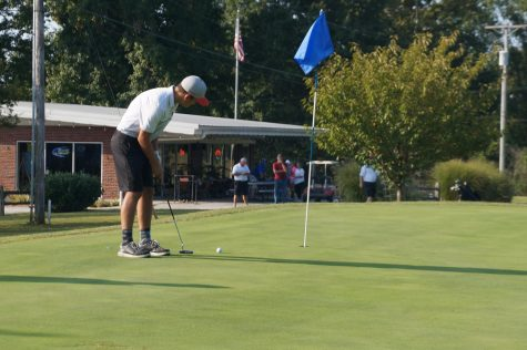 Luke Miller sinks a putt in the match Sept. 21 at Sparta.