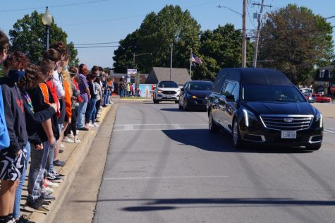 "Chester students lined Swanwick Street to pay their respects to Brian ""Gritty"" Snider on Oct. 1. The funeral procession for Mr. Snider, the pre-eminent Chester High School sports reporter, passed by the high school."