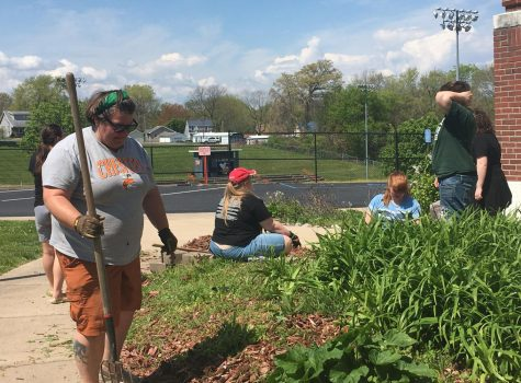 Members of the Environmental Club did some weeding in front of the school.