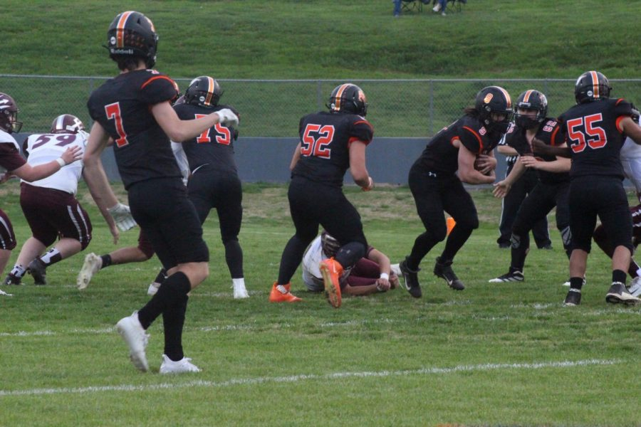 Dylan Kelkhoff rushes for a gain against Sesser.
