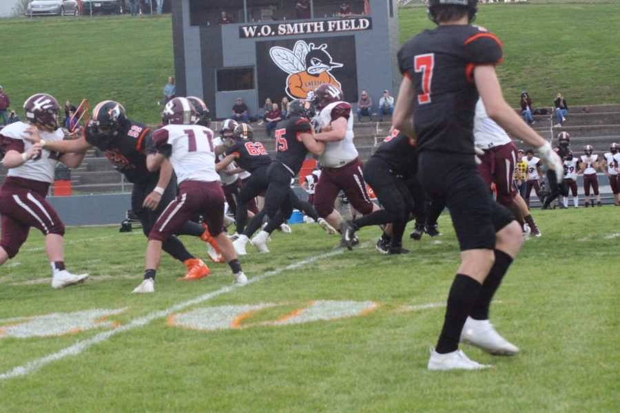Tyler Holm (52), Eli Hughes (62) and Bradley Ruch (75) were among the linemen battling in the trenches against Sesser.
