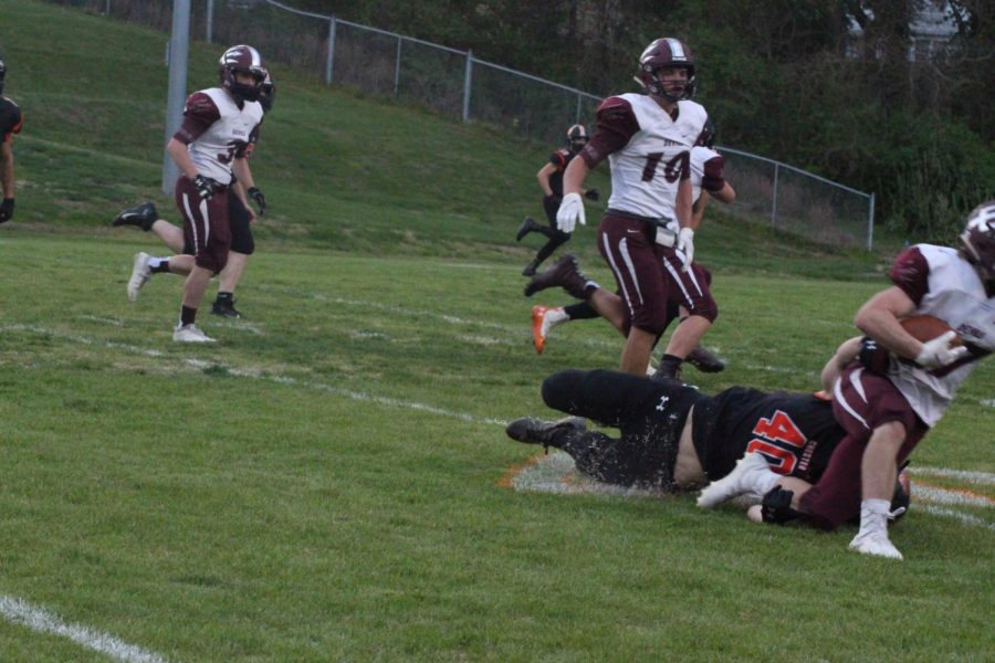 Isaac Jany makes a tackle against Sesser.