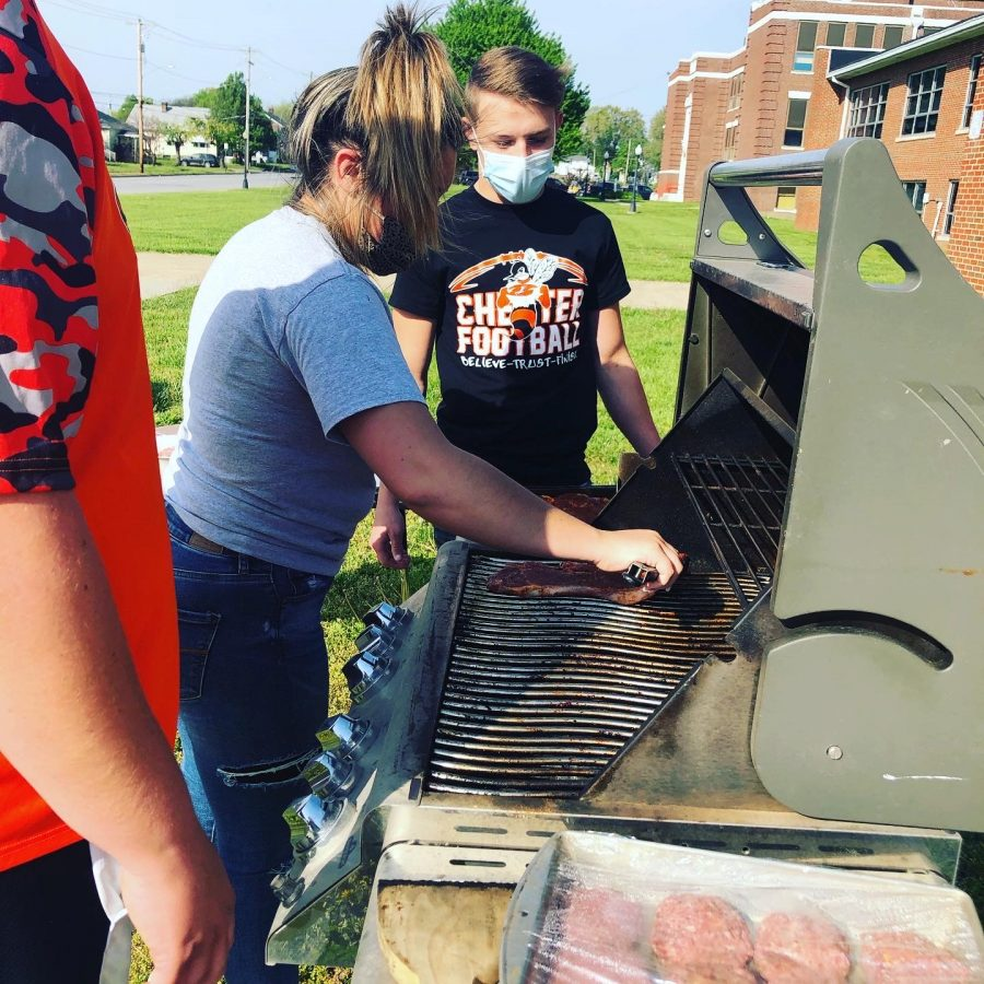 Kyndl Stewart-McDonough and Jake Cowell grill during a Food II unit.