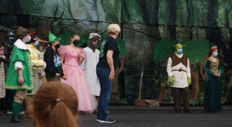 """Mrs. Coop directs the cast of """"Shrek"""" during a recent rehearsal. This will be her last production, as she is retiring after this school year."""