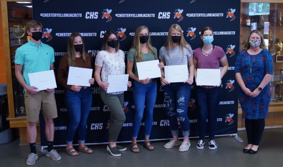Nate Heffernan, Peyton Clendenin, Macey Ludwig, Josie Kattenbraker, Katie Shinabargar and Melody Colonel were recip[ients of the American Legion scholarship. Making the presentation is Mrs. Wolter, CHS guidance counselor.
