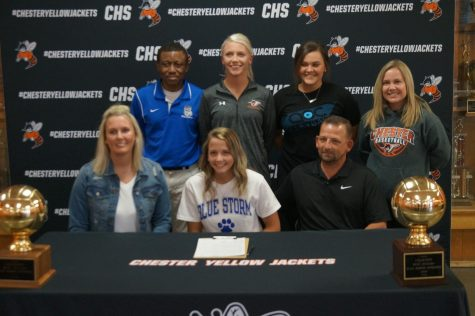 Kendall Williams, surrounded by her parents and coaches, sighed a letter of intent to play volleyball at Southwestern Illinois College.