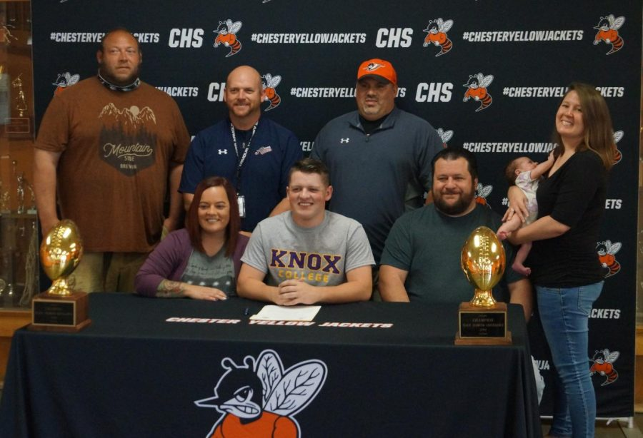 Daigen+Hunter+%28seated%2C+center%29+signed+a+letter+of+intent+to+play+football+at+Knox+College.