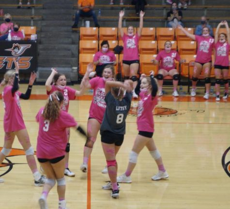 The Lady Yellow Jackets celebrate a point against Red Bud.