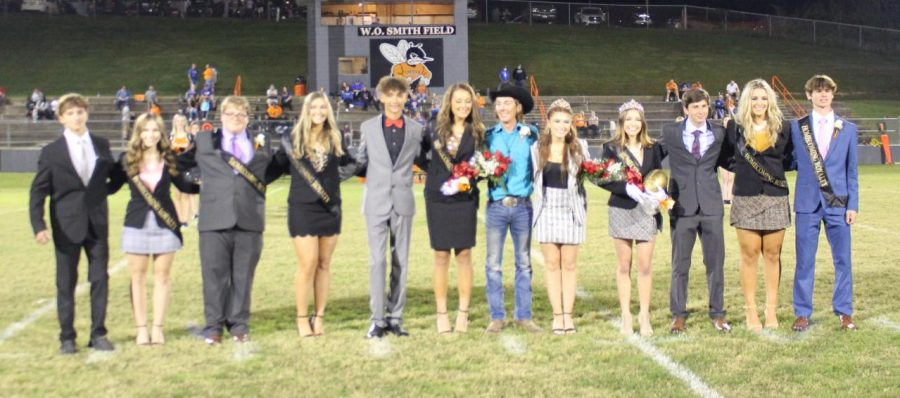 Hannah Blechle (fourth from right) was crowned Homecoming queen. Kaitlyn Absher (sixth fromleft) was first runner-up.